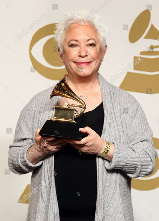 """Janis Ian poses backstage with the best spoken word album award for """"Society's Child: My Autobiography"""" at the 55th annual Grammy Awards, in Los Angeles"""