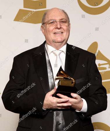 "Stock Picture of Billy Vera poses backstage with the best album notes award for ""Singular Genius: The Complete ABC Singles"" at the 55th annual Grammy Awards, in Los Angeles"