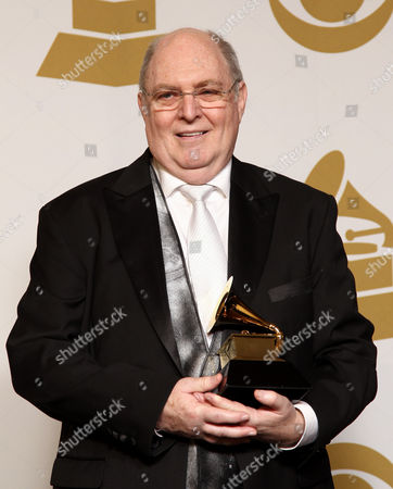"Stock Image of Billy Vera poses backstage with the best album notes award for ""Singular Genius: The Complete ABC Singles"" at the 55th annual Grammy Awards, in Los Angeles"