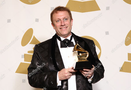 """Charles Bruffy poses backstage with the choral performance award for """"Life and Breath: Choral Works by Rene Clausen"""" at the 55th annual Grammy Awards, in Los Angeles"""