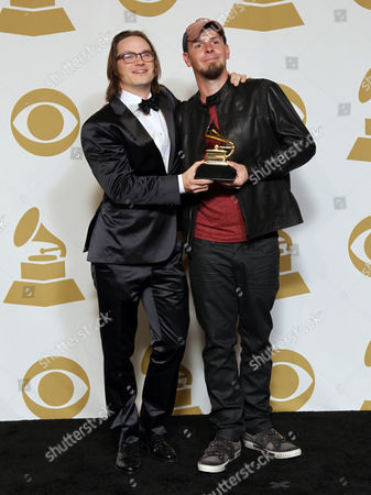 """Josh Kear, left, and Chris Tompkins pose backstage with the award for best country song for """"Blown Away"""" at the 55th annual Grammy Awards, in Los Angeles"""