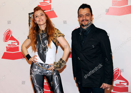 """Members of the musical group JotDog, from left, Maria Barracuda, and Jorge """"La Chiquis"""" Amaro arrive at the Latin Recording Academy Person of the Year tribute, in Las Vegas"""