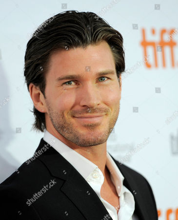 "Christopher Russell, a cast member in ""The Right Kind of Wrong,"" poses at the premiere of the film on day 8 of the 2013 Toronto International Film Festival at Roy Thomson Hall on in Toronto"