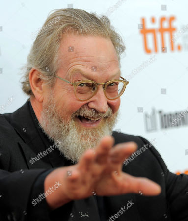 """Stock Image of Jeremiah Chechik, director of """"The Right Kind of Wrong,"""" reacts to photographers at the premiere of the film on day 8 of the 2013 Toronto International Film Festival at Roy Thomson Hall, in Toronto"""