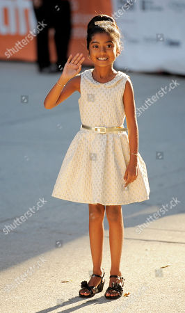 """Stock Photo of Maya Samy, a cast member in """"The Right Kind of Wrong,"""" waves to photographers at the premiere of the film on day 8 of the 2013 Toronto International Film Festival at Roy Thomson Hall on in Toronto"""