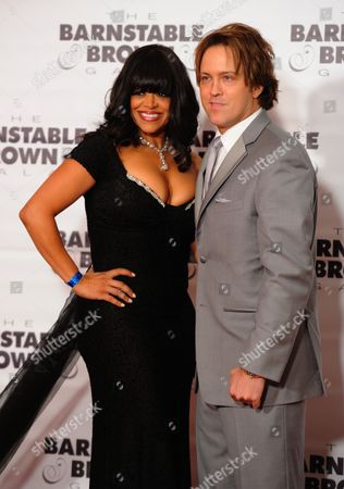 Larry Birkhead (right) and Stacy Francis arrive at the Barnstable Brown Derby gala, in Louisville, Ky. The 140th Kentucky Derby will be held Saturday, May 3