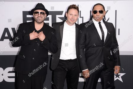 Mark Calderon, from left, Martin Kember and Kevin Thornton of musical group Color Me Badd pose in the press room at the BET Awards at the Nokia Theatre, in Los Angeles