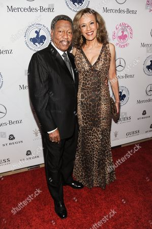 Billy Davis Jr., left, and Marilyn McCoo arrive at the 2014 Carousel Of Hope Ball, in Beverly Hills, Calif