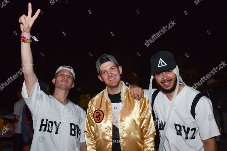 Josh Young of Flosstradamus, Dillion France, and Curt Cameruci Flosstradamus, pose for a photo at the 2014 Coachella Music and Arts Festival, in Indio, Calif