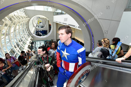 Matt Rogers, dressed as Captain America, rides the escalator up on day 1 of the 2014 Comic-Con International Convention held in San Diego