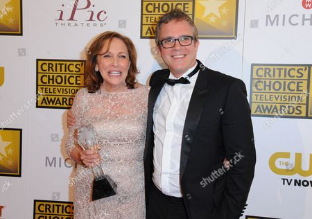 """Ann Druyan, left, and Brannon Braga pose in the press room with the award for best reality series for """"Cosmos: A Spacetime Odyssey"""" at the Critics' Choice Television Awards at the Beverly Hilton Hotel, in Beverly Hills, Calif"""