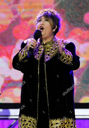 "Tata Vega of ""Twenty Feet from Stardom"" performs on stage at the 2014 Film Independent Spirit Awards,, in Santa Monica, Calif"