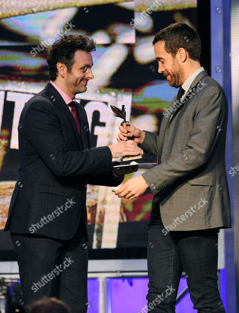 """Michael Sheen, left, presents Nat Sanders with the award for best editing for """"Short Term 12"""" on stage at the 2014 Film Independent Spirit Awards,, in Santa Monica, Calif"""
