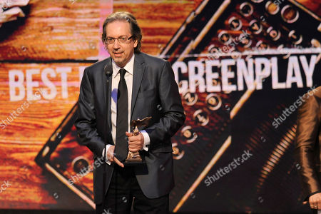 """Bob Nelson accepts the award for best first screenplay for """"Nebraska"""" on stage at the 2014 Film Independent Spirit Awards,, in Santa Monica, Calif"""
