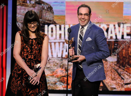 "Cherie Saulter, left, and Chad Hartigan accept the John Cassavetes award for ""This is Martin Bonner"" on stage at the 2014 Film Independent Spirit Awards,, in Santa Monica, Calif"