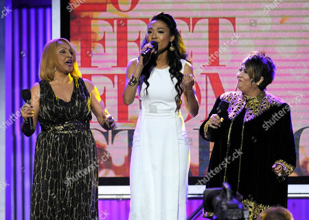"From left, Darlene Love, Judith Hill and Tata Vega of ""Twenty Feet from Stardom"" perform on stage at the 2014 Film Independent Spirit Awards,, in Santa Monica, Calif"