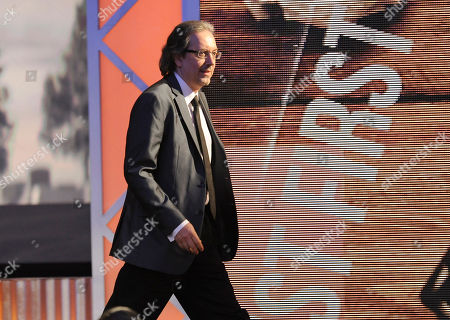 """Bob Nelson walks on stage to accept the award for best first screenplay for """"Nebraska"""" at the 2014 Film Independent Spirit Awards,, in Santa Monica, Calif"""