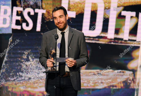 """Nat Sanders accepts the award for best editing for """"Short Term 12"""" on stage at the 2014 Film Independent Spirit Awards,, in Santa Monica, Calif"""