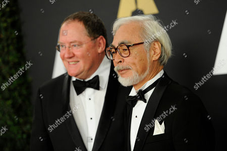 John Lasseter left, and Hayao Miyazaki arrive at the 6th annual Governors Awards at the Hollywood and Highland Center on in Los Angeles