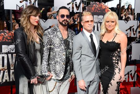 From left, Rochelle Karidis, A.J. McLean, Brian Littrell, and Leighanne Wallace arrives at the MTV Movie Awards, at Nokia Theatre in Los Angeles