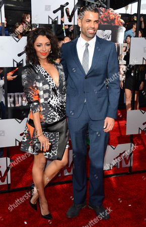 Kat Graham, left, and Cottrell Guidry arrive at the MTV Movie Awards, at Nokia Theatre in Los Angeles