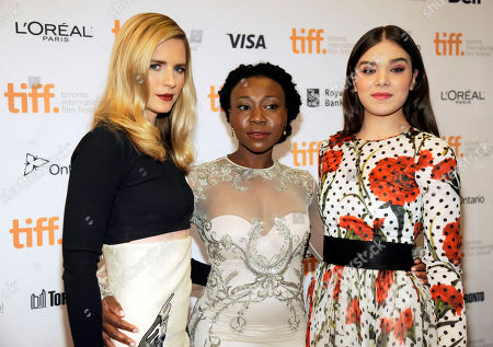 """Brit Marling, from left, Muna Otaru and Hailee Steinfeld attend the premiere of """"The Keeping Room"""" on day 5 of the Toronto International Film Festival at the TIFF Bell Lightbox, in Toronto"""