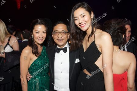 Stock Picture of From left, Michelle Yeoh, Silas Chou, and Liu Wen attend the inaugural amfAR Hong Kong gala on in Hong Kong