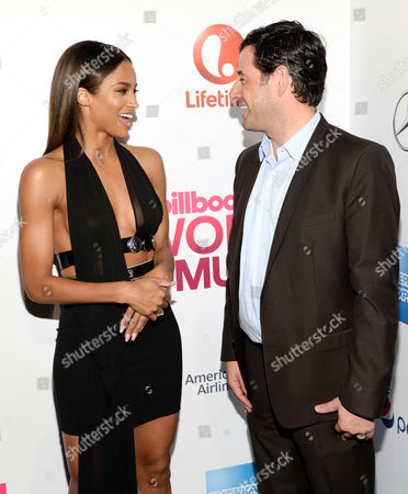 Singer Ciara, left, chats with A&E and Lifetime Networks executive vice president and general manager Rob Sharenow at the 2015 Billboard Women in Music honors at Cipriani 42nd Street, in New York
