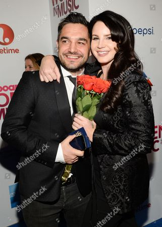 "Billboard ""Trailblazer"" honoree Lana Del Ray poses with her manager Ben Mawson at the 2015 Billboard Women in Music honors at Cipriani 42nd Street, in New York"