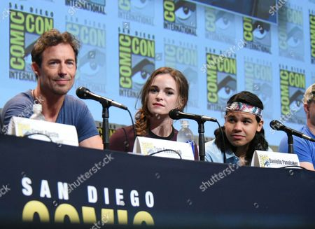 "Tom Cavanagh, from left, Danielle Panabake and Carlos Valdes attend the ""The Flash"" panel on day 3 of Comic-Con International, in San Diego"