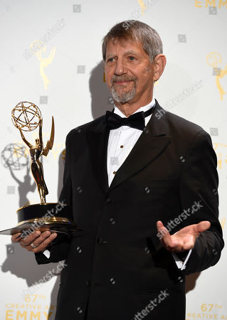 """Peter Coyote, winner of the award for narrator for """"The Roosevelts: An Intimate History,"""" poses in the press room at the Creative Arts Emmy Awards at the Microsoft Theater, in Los Angeles"""