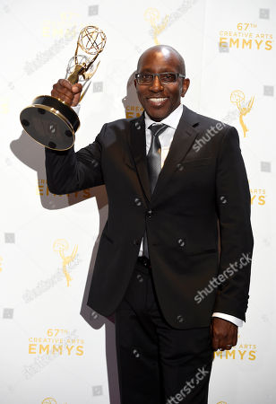 "Greg Phillinganes, winner of the award for musical direction for Stevie Wonder: Songs in the Key of Life, an All-Star Grammy Salute,"" poses in the press room at the Creative Arts Emmy Awards at the Microsoft Theater, in Los Angeles"
