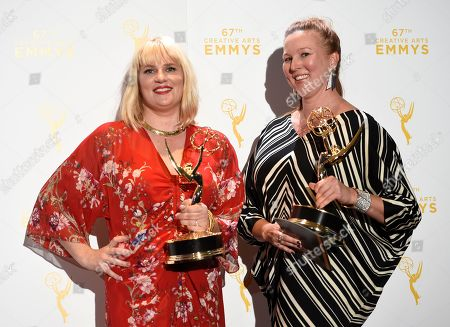 """Marie Schley, from left, and Nancy Jarzynko, winners of the awards for costumes - contemporary for """"Transparent"""", pose in the press room at the Creative Arts Emmy Awards at the Microsoft Theater, in Los Angeles"""