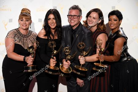 """Daina Daigle, from left, Michelle Ceglia, Monte C. Haught, Amy Wood, Sherri B. Hamilton, winners of the award for hairstyling - limited series for American Horror Story: Freak Show"""" pose in the press room at the Creative Arts Emmy Awards at the Microsoft Theater, in Los Angeles"""