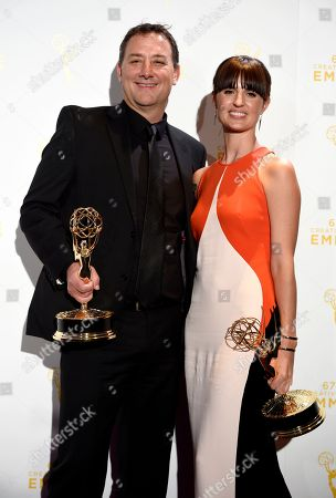 """Mathew Waters, left, and Onnalee Blank, winners of sound mixing for hourlong for """"Game of Thrones,"""" pose in the press room at the Creative Arts Emmy Awards at the Microsoft Theater, in Los Angeles"""