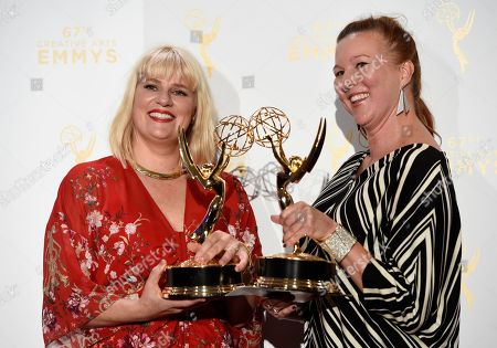 """Marie Schley, left, and Nancy Jarzynko, winners of the award for outstanding costumes for a contemporary series, limited series or movie for """"Transparent,"""" pose in the press room at the Creative Arts Emmy Awards at the Microsoft Theater, in Los Angeles"""