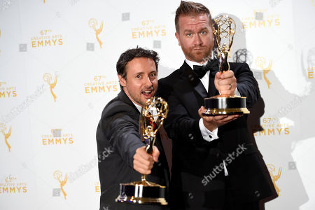 Kyle Dunnigan, left, and Jim Roach, winners of the award for original music and lyrics for Inside Amy Schumer - Cool With It/Song Title: Girl You Don't Need Make Up pose in the press room at the Creative Arts Emmy Awards at the Microsoft Theater, in Los Angeles