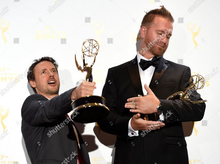 "Kyle Dunnigan, left, and Jim Roach, winners of the award for original music and lyrics for Inside Amy Schumer,"" from episode ""Cool With It"" for song ""Girl You Don't Need Make Up,"" pose in the press room at the Creative Arts Emmy Awards, in Los Angeles"