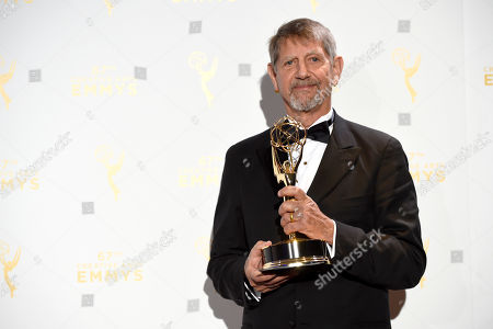 """Peter Coyote, winner of the award for outstanding narrator for """"The Roosevelts: An Intimate History,"""" poses in the press room at the Creative Arts Emmy Awards at the Microsoft Theater, in Los Angeles"""