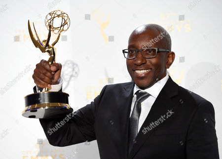 "Greg Phillinganes, winner of the award for Outstanding Music Direction for ""Stevie Wonder: Songs in the Key of Life, an All-Star Grammy Salute,"" poses in the press room at the Creative Arts Emmy Awards, in Los Angeles"