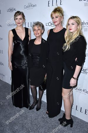 From left, Dakota Johnson, Tippi Hedren, Melanie Griffith and Stella Banderas attend the 2015 ELLE Women in Hollywood Awards at the Four Seasons Hotel on in Los Angeles, California