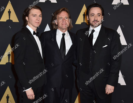 Paul Dano, from left, Bill Pohlad, and John Cusack arrive at the Governors Awards at the Dolby Ballroom, in Los Angeles