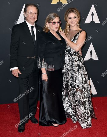 Todd Fisher, from left, Carrie Fisher, and Billie Catherine Lourd arrive at the Governors Awards at the Dolby Ballroom, in Los Angeles