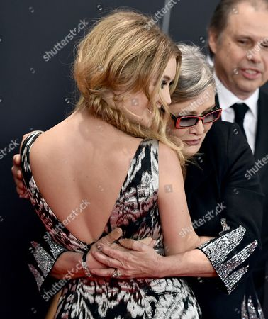 Billie Catherine Lourd, left, and Carrie Fisher arrive at the Governors Awards at the Dolby Ballroom, in Los Angeles