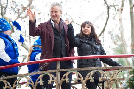Musicians Neil Giraldo, left, and Pat Benatar participate in the Macy's Thanksgiving Day Parade, in New York