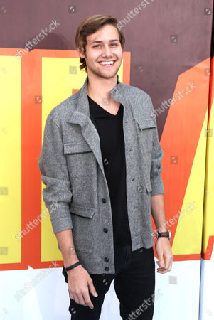 Stock Image of Caleb Ruminer arrives at the MTV Movie Awards at the Nokia Theatre, in Los Angeles