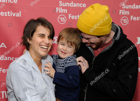 "Stock Image of Jude Swanberg Kris Swanberg, left, director and co-writer of ""Unexpected,"" poses with her husband, filmmaker Joe Swanberg, and their son Jude at the Library Center Theatre during the 2015 Sundance Film Festival, in Park City, Utah"