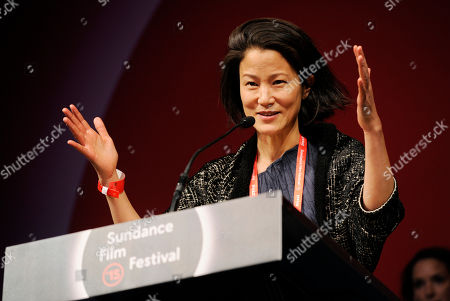"""Stock Photo of Jacqueline Kim, co-writer/producer of """"Advantageous,"""" accepts the U.S. Dramatic Special Jury Award: Collaborative Vision for the film during the 2015 Sundance Film Festival Awards Ceremony, in Park City, Utah"""