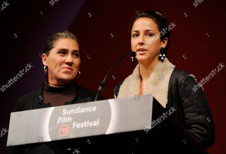 "Stock Picture of Brazilian actress Camila Mardila a cast member in ""The Second Mother,"" accepts the World Cinema Dramatic Special Jury Award for Acting as the film's writer/director Anna Muylaert looks on during the 2015 Sundance Film Festival Awards Ceremony, in Park City, Utah"