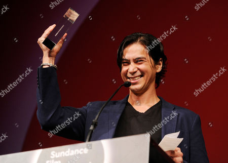 "Kalani Queypo, a cast member in ""Slow West,"" accepts the World Cinema Drama Grand Jury Prize for the film during the 2015 Sundance Film Festival Awards Ceremony, in Park City, Utah"
